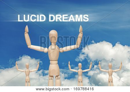Wooden dummy puppet on sky background with words LUCID DREAMS. Abstract conceptual image