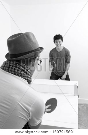 Multiethnic friends playing table tennis