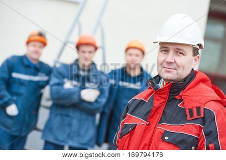 team of construction workers technicians with foreman in front