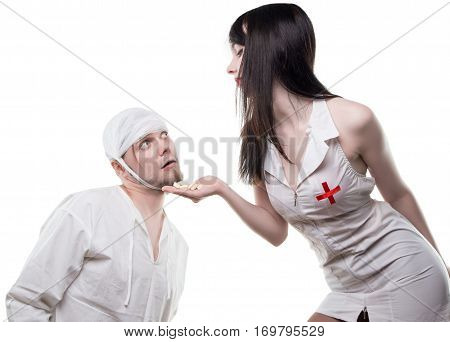 Nurse offers analgetic drugs on white background