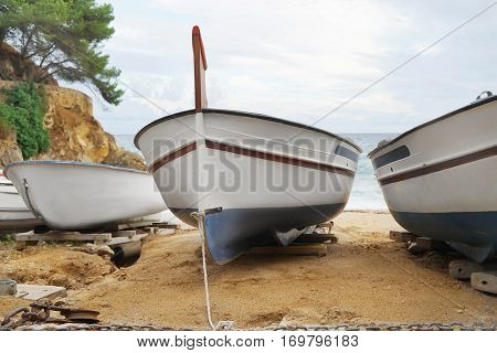 Close up view of boats on sand near sea