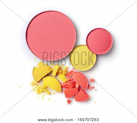Round Pink Blusher With Yellow And Orange Crashed Eyeshadow For Make Up As Sample Of Cosmetics Produ