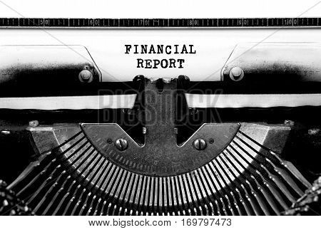 FINANCIAL REPORT Typed Words On a Vintage Typewriter Conceptual