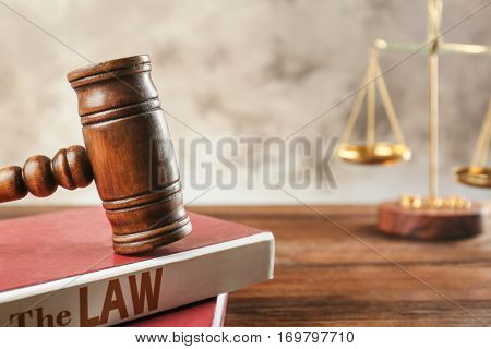 Court gavel with books, closeup
