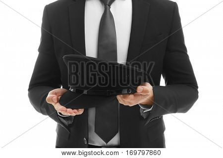 Closeup of chauffeur holding hat on white background