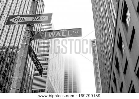Famous Wall Street sign in the street of Manhattan, New York City, USA