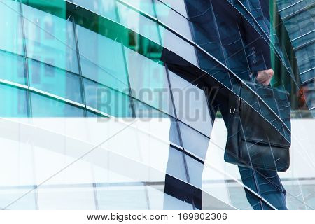 Abstract double exposure of businessman and office buildings, rush hours concept