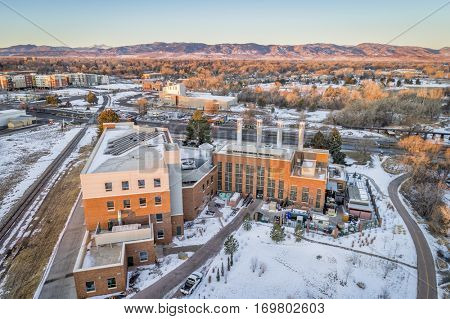 FORT COLLINS, CO, USA - DECEMBER 24, 2016: Powerhouse Energy Campus of Colorado State University - new building completed in 2014 and historic Municipal Power Plant, aerial view at winter sunrise.