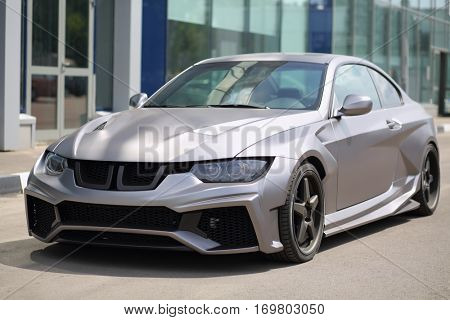 MOSCOW - JUN 19, 2016: Sport model car BMW silver colored standing near the glass building