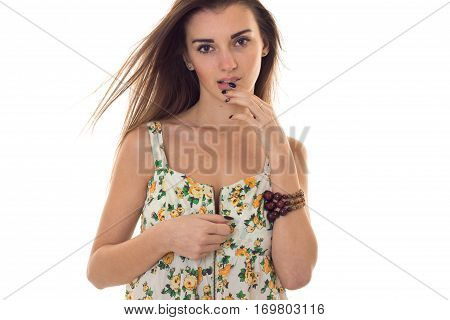 seductive young woman in sarafan with floral pattern unbuttoning clothes isolated on white