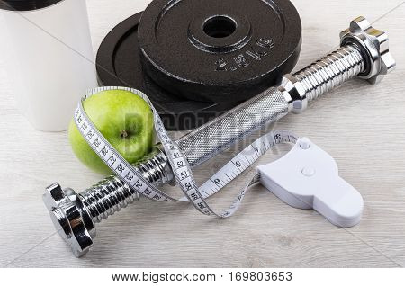 Disassembled Dumbbell, Green Apple And Measures Tape