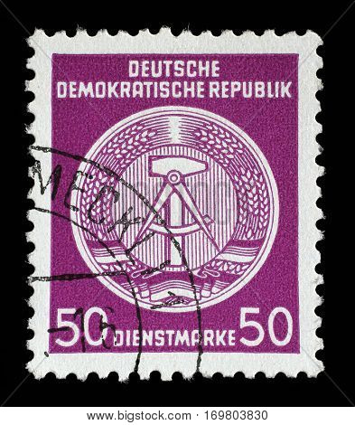 ZAGREB, CROATIA - SEPTEMBER 05: A Stamp printed in GDR (East Germany) shows DDR national coat of arms with inscription Service Stamp, circa 1952, on September 05, 2014
