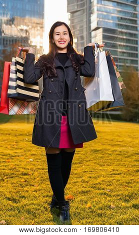 Two Asian Woman Holding Shopping Bags In Hand