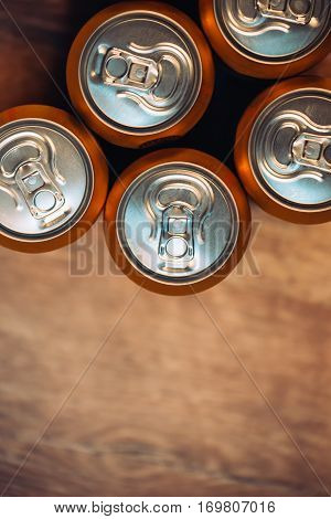 Beer cans on rustic wooden table top view with copy space