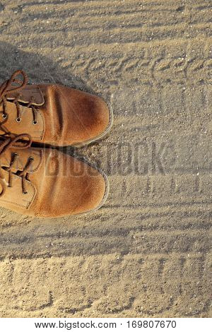 Feet in shoes on countryside road background