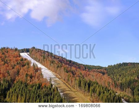 Landscape with mountain and forest on autumn day