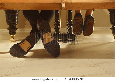 Musician and child's feet, underside view