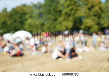 Blurred background of people at open air concert