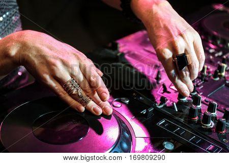 DJ mixing music, closeup