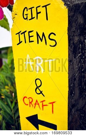 Gift items art and craft bright conspicuous yellow handmade promo sign outdoor