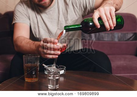 Lonely man drinking alcohol.