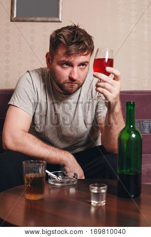 Grunge man with glass of alcohol