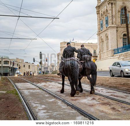 Mounted police patrol the streets in Jerusalem, Israel