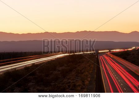 Nighttime traffic on Interstate I-10 through the desert in California