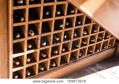 Bottles of great red and white wine with corks in a winery cellar