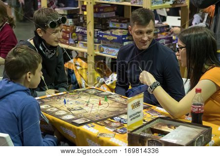 Moscow, Russia - November 19, 2016: People playing table game at the Gamefilmexpo festival dedicated to video games, TV series and comics, anime, manga, cosplay.