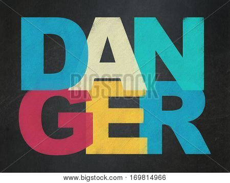 Protection concept: Painted multicolor text Danger on School board background, School Board