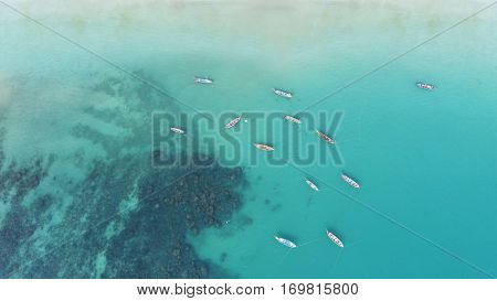 Aerial view of long tail boats on the sea near Kata beach in Phuket, Thailand