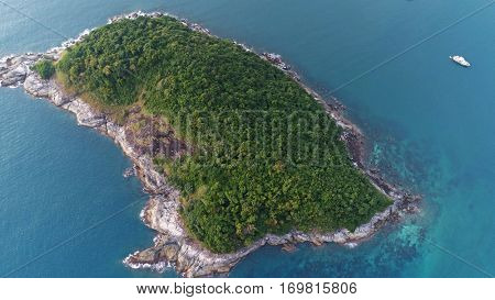 Aerial shot of Koh Bon island and boat on the sea over sky background in Phuket, Thailand