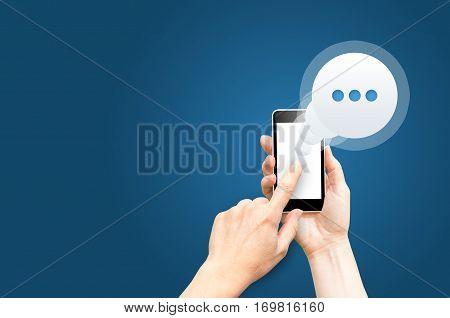 Message on smartphone screen. Hand holds smartphone finger touches screen. Messaging concept