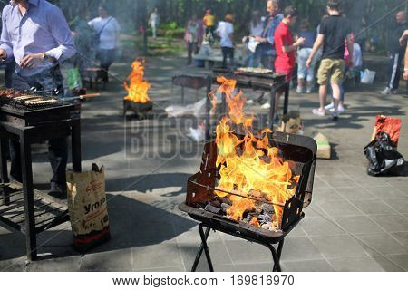 MOSCOW - MAY 08, 2016: Metal brazier with fire for shashlik in the barbecue area in Ostankino park