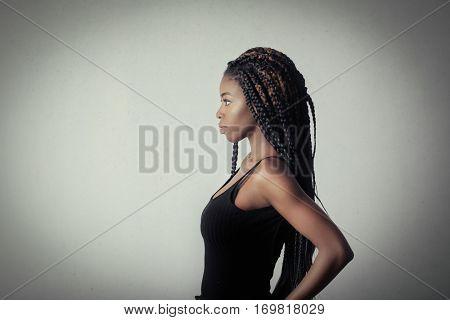 Profile of a black girl in black top