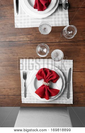 Elegant table appointments with red napkin