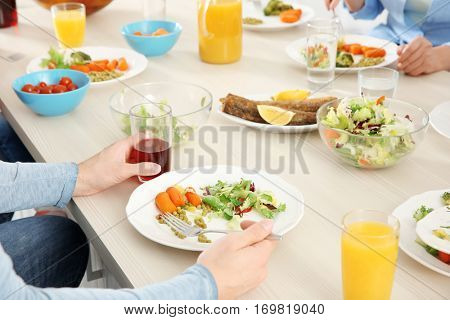 Close up view of man having lunch at home