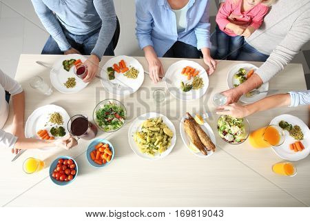Family having lunch in kitchen