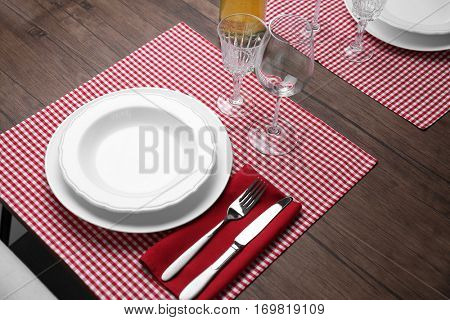 Elegant table appointments with checkered napkin