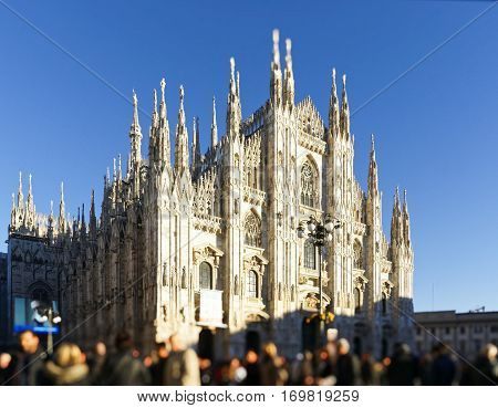looking Duomo di Milano meaning Milan Cathedral in Italy with blue sky in winter time