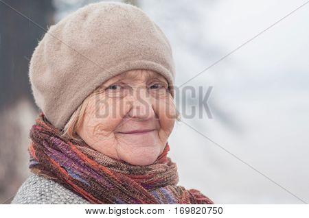 Older cute blonde woman in 60 years