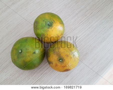 Oranges on wooden table texture pattern background