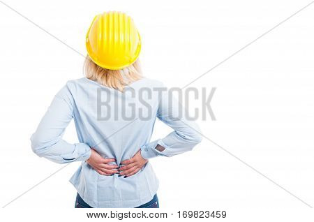 Back View Of Female Engineer Holding Her Back For Pain