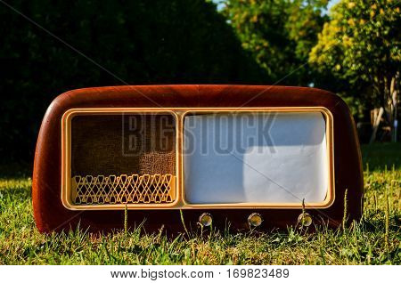 Old Radio On A Grass Background