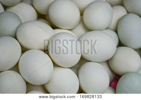 Many fresh duck eggs as background seamless