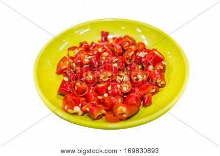 Sliced Chili in yellow dish Isolated Red hot Chili slice Spicy Thai Chili in yellow bowl on white background Asian ingredient
