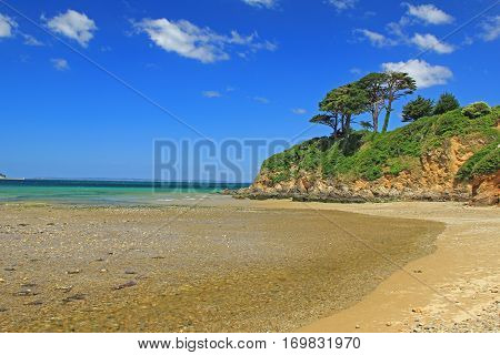 Atlantic coast with cliff and blue sky near Douarnenez Brittany France