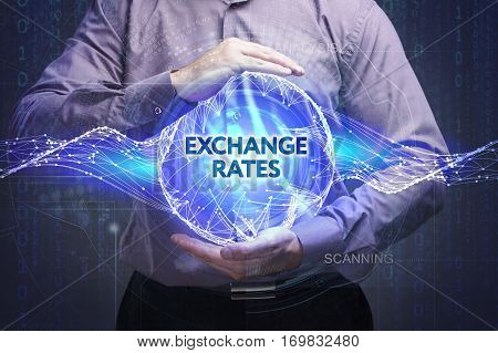 Business, Technology, Internet And Network Concept. Young Businessman Shows The Word: Exchange Rates