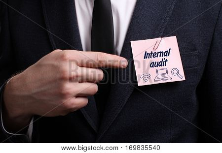 Business, Technology, Internet And Network Concept. Young Businessman Shows The Word: Internal Audit
